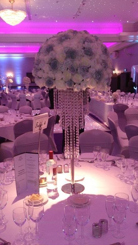 Glitzy crystal chandelier wedding centrepiece