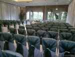 Chair covers with tied organza chair hoods.jpg